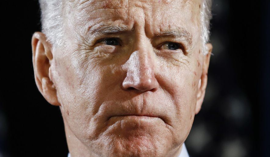 Democratic presidential candidate former Vice President Joe Biden speaks about the coronavirus in Wilmington, Delaware, March 12, 2020. Biden has won Wyoming's Democratic presidential caucus, which had been postponed for two weeks and scaled back to just mail-in ballots because of the coronavirus pandemic, state party officials said Sunday, April 19. (AP Photo/Matt Rourke) ** FILE **