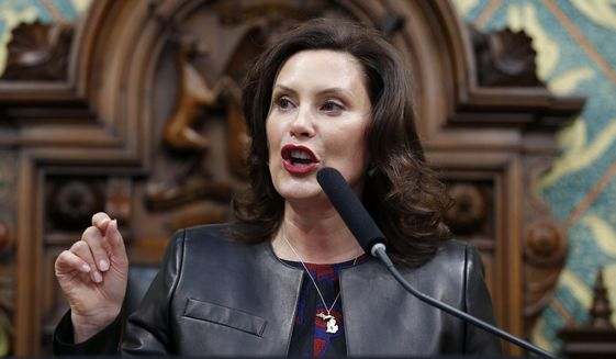In this Jan. 29, 2020, file photo Michigan Gov. Gretchen Whitmer delivers her State of the State address to a joint session of the House and Senate at the state Capitol in Lansing, Mich. Across an arc of vital swing states, the coronavirus has put politics on an uneasy pause. The tension is most pronounced in Michigan, where the outbreak is far worse than in any of the other northern political battlegrounds. (AP Photo/Al Goldis, File)