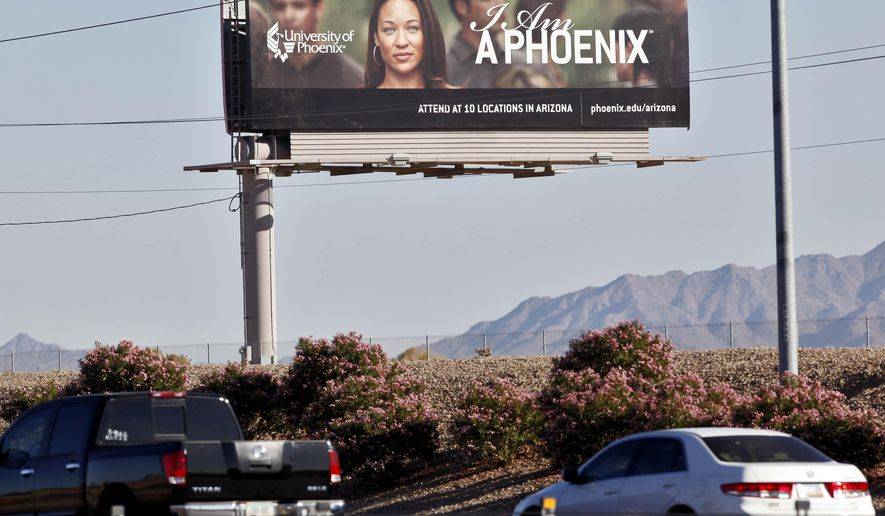 FILE - In this Nov 24, 2009 file photo, a University of Phoenix billboard is shown in Chandler, Ariz. Some of the nation's largest for-profit colleges are ramping up advertising, hiring recruiters and offering discounts for online classes as they predict that the coronavirus will steer more Americans back to school, helping revive the industry. (AP Photo/Matt York, File)