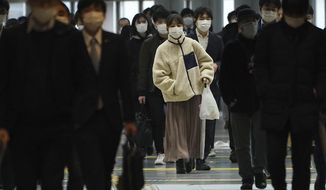 A station passageway is crowded with face mask wearing commuters during a rush hour Monday, April 20, 2020, in Tokyo. Japan's Prime Minister Shinzo Abe expanded a state of emergency to all of Japan from just Tokyo and other urban areas as the virus continues to spread. (AP Photo/Eugene Hoshiko)