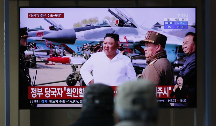 People watch a TV screen showing a news program reporting about North Korean leader Kim Jong-un with a file image at the Seoul Railway Station in Seoul, South Korea, Tuesday, April 21, 2020. The South Korean government is looking into unconfirmed reports saying North Korean leader Kim is in fragile condition after surgery. (AP Photo/Lee Jin-man)