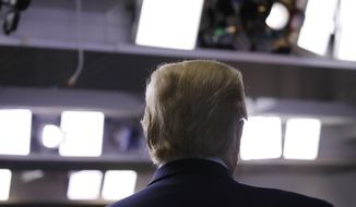 President Donald Trump listens during a briefing about the coronavirus in the James Brady Press Briefing Room of the White House, Monday, April 20, 2020, in Washington. (AP Photo/Alex Brandon)