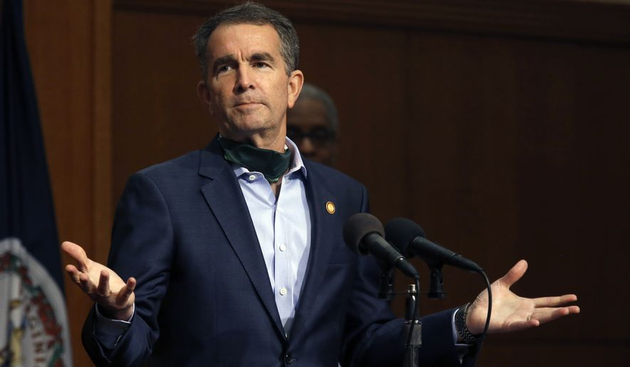 Virginia Gov. Ralph Northam gestures while answering a question during his press briefing inside the Patrick Henry Building in Richmond, Va., Monday, April 20, 2020. (Bob Brown/Richmond Times-Dispatch via AP)
