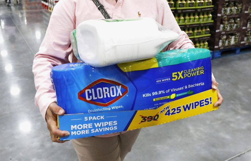 In this March 12, 2020, photo, a Costco customer buys cleaning supplies in Ridgeland, Miss. Reports of accidental poisonings from cleaners and disinfectants are up sharply, and researchers believe it's related to the coronavirus epidemic. Such poisonings were up about 20 percent in the first three months of this year, compared to the same periods in 2018 and 2019.. The Centers for Disease Control and Prevention released the report Monday, April 20. (AP Photo/Rogelio V. Solis) **FILE**