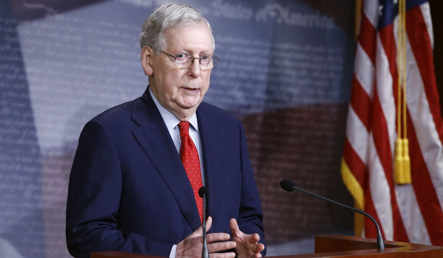 In this file photo, Senate Majority Leader Mitch McConnell, Kentucky Republican, speaks with reporters after the Senate approved a nearly $500 billion coronavirus aid bill on Capitol Hill in Washington on Tuesday, April 21, 2020. (Associated Press) **FILE**