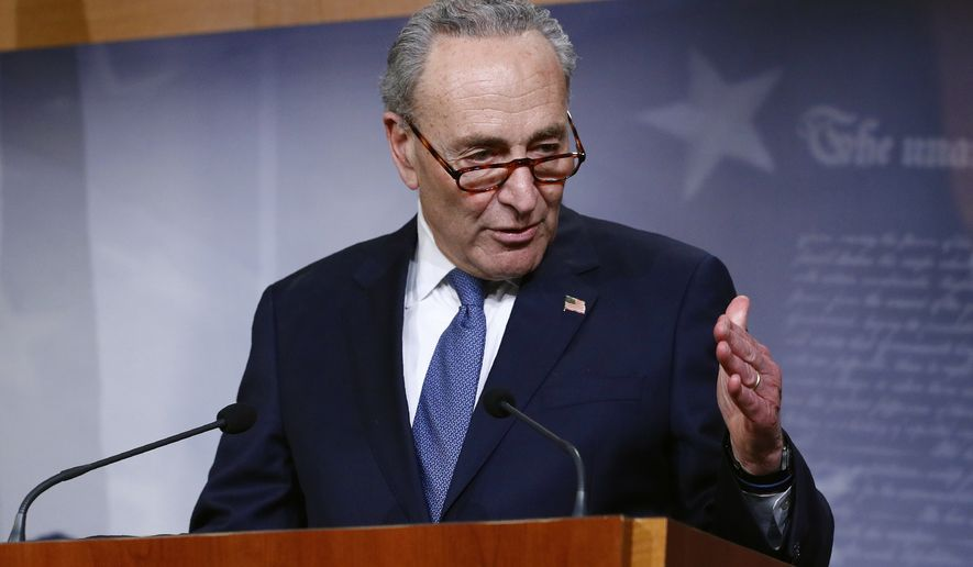 Senate Minority Leader Sen. Chuck Schumer of N.Y., speaks with reporters after the Senate approved a nearly $500 billion coronavirus aid bill, Tuesday, April 21, 2020, on Capitol Hill in Washington. (AP Photo/Patrick Semansky) **FILE**