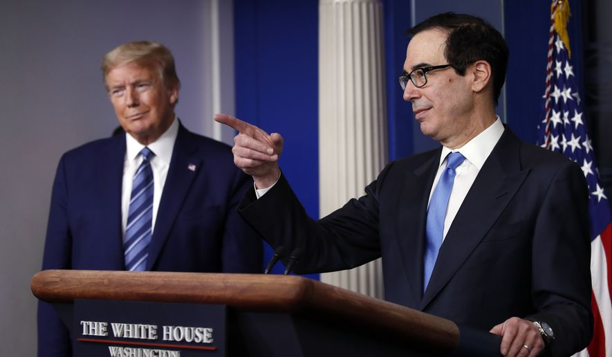 President Donald Trump listens as Treasury Secretary Steven Mnuchin speaks about the coronavirus in the James Brady Press Briefing Room of the White House, Tuesday, April 21, 2020, in Washington. (AP Photo/Alex Brandon) ** FILE **