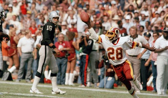 In this Oct. 2, 1983, file photo, Washington Redskins' Darrell Green (28) reacts during an NFL football game against the Los Angeles Raiders in Washington. The Redskins have drafted nine Pro Football Hall of Famers and made plenty of big-time mistakes throughout franchise history. Cornerback Green became a building block for two Super Bowl-winning teams after being taken with the last pick in the first round in 1983. (AP Photo/Pete Wright, File)
