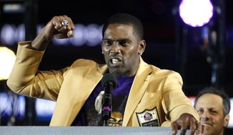 FILE - In this Nov. 25, 2018, file photo, former Minnesota Vikings wide receiver Randy Moss speaks after receiving his Hall of Fame ring during halftime of an NFL football game between the Vikings and the Green Bay Packersin Minneapolis. The Vikings have drafted six Hall of Famers in the first round. None made more of a splash than Randy Moss in 1998.(AP Photo/Bruce Kluckhohn, File)