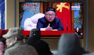 People watch a TV screen showing a news program reporting about North Korean leader Kim Jong Un with a file image at the Seoul Railway Station in Seoul, South Korea, Tuesday, April 21, 2020. The South Korean government is looking into unconfirmed reports saying North Korean leader Kim is in fragile condition after surgery. (AP Photo/Lee Jin-man)