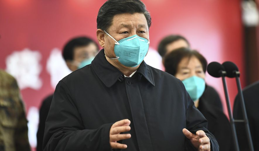In this March 10, 2020, file photo released by China's Xinhua News Agency, Chinese President Xi Jinping talks by video with patients and medical workers at the Huoshenshan Hospital in Wuhan in central China's Hubei Province.  (Xie Huanchi/Xinhua via AP) ** FILE **
