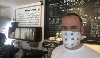 """In this April 17, 2020, photo, Zachary Davis poses for a photo at The Penny Ice Creamery in Santa Cruz, Calif. An investigation by The Associated Press hows that many large companies which collectively received tens of millions of dollars in federal loans through the Paycheck Protection Program were at risk of failing even before the coronavirus walloped the economy, while others have acknowledged problems keeping their finances straight and a few have been under investigation by the Securities and Exchange Commission. That big companies and ones with questionable records received such precious financial aid during the chaotic last few weeks frustrates Davis, """"We were feeling pretty good about where we were in the world. Now it's just all turned upside down,"""" said Davis, who had to lay off 70 workers. (AP Photo/Martha Mendoza)"""