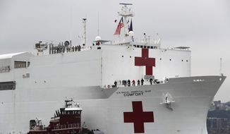 In this March 30, 2020, file photo, the U.S. Navy hospital ship USNS Comfort is escorted up the Hudson River on its way to New York City. (AP Photo/Kathy Willens) ** FILE **