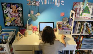 This April 9, 2020, photo released by Kara Illig shows her daughter, Ainslie Illig, 8, on her computer in Ebensburg, Pa. The frustration of parents is mounting as more families across the U.S. enter their second or even third week of total distance learning, and some say it will be their last. (Kara Illig via AP)  **FILE**