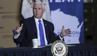 Vice President Mike Pence visits the GE Healthcare manufacturing facility Tuesday, April 21, 2020, in Madison, Wis. (AP Photo/Morry Gash)