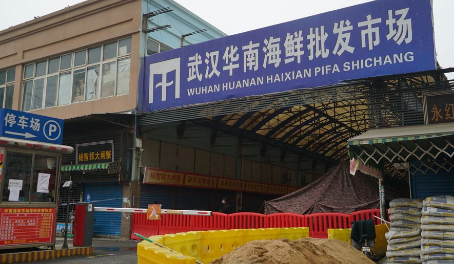 The Wuhan Huanan Wholesale Seafood Market, where a number of people related to the market fell ill with a virus, sits closed in Wuhan, China, Tuesday, Jan. 21, 2020. Heightened precautions were being taken in China and elsewhere Tuesday as governments strove to control the outbreak of the coronavirus, which threatens to grow during the Lunar New Year travel rush. (AP Photo/Dake Kang) **FILE**