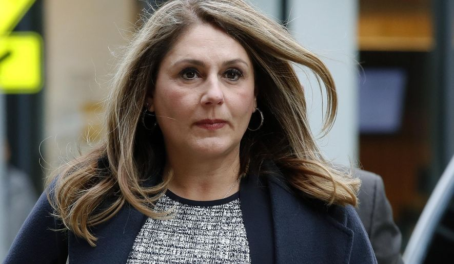 FILE - In this Feb. 25, 2020, file photo, Michelle Janavs arrives at federal court in Boston for sentencing in a nationwide college admissions bribery scandal. Lawyers for Janavs, who is supposed to report to prison in May, said in a legal filing Wednesday, April 22, 2020, that she should spend five months in home confinement instead of prison because she has an underlying health condition that makes her particularly vulnerable if she were to contract the coronavirus. (AP Photo/Elise Amendola, File)