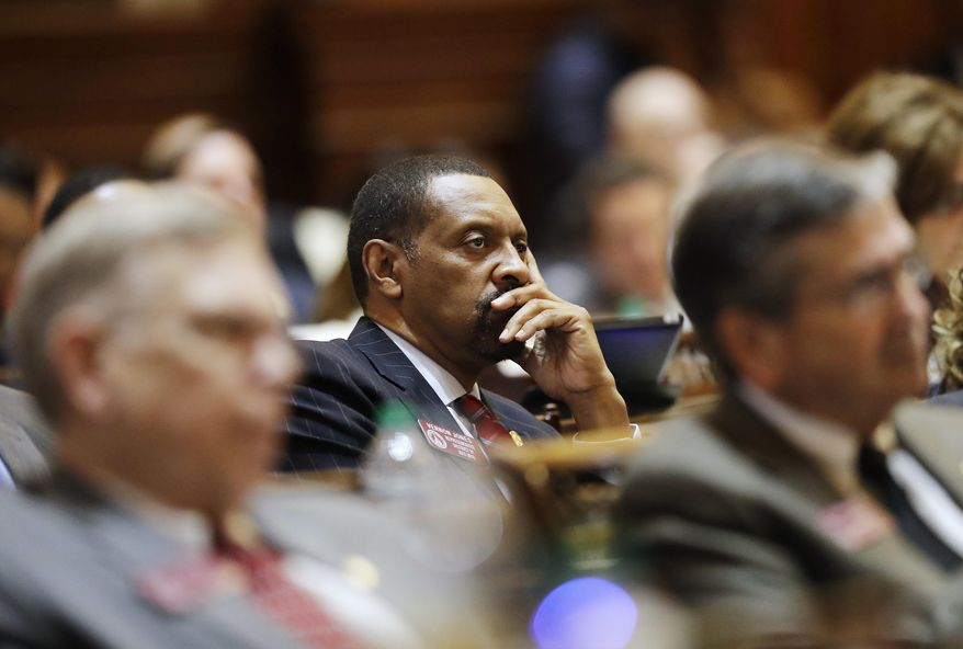 In this Jan. 11, 2017, file photo, Rep. Vernon Jones listens as Georgia Gov. Nathan Deal delivers the State of the State address on the House floor in Atlanta. Jones, a polarizing Democratic state lawmaker in Georgia, broke party ranks on Tuesday, April 14, 2020, to endorse President Donald Trump's reelection. Jones, who represents portions of metro Atlanta's DeKalb and Rockdale counties, told the Atlanta Journal-Constitution that he's supporting Trump because of the Republican president's handling of the economy and his criminal justice reform efforts. (AP Photo/David Goldman, File)