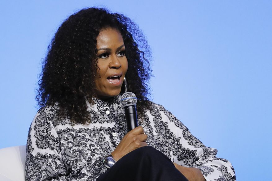 In this Dec. 12, 2019, file photo, former first lady Michelle Obama speaks during an event for Obama Foundation in Kuala Lumpur, Malaysia. (AP Photo/Vincent Thian, File)