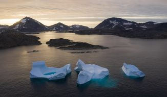 FILE - In this Aug. 16, 2019, photo, large Icebergs float away as the sun rises near Kulusuk, Greenland. The Trump administration is poised to announce an expanded diplomatic presence in Greenland and a new assistance package for the vast island aimed at thwarting growing Chinese and Russian influence in the Arctic. The announcement, expected Thursday, April 23, 2020, will come less than a year after President Donald Trump drew derision for expressing an interest in buying Greenland. (AP Photo/Felipe Dana, File)