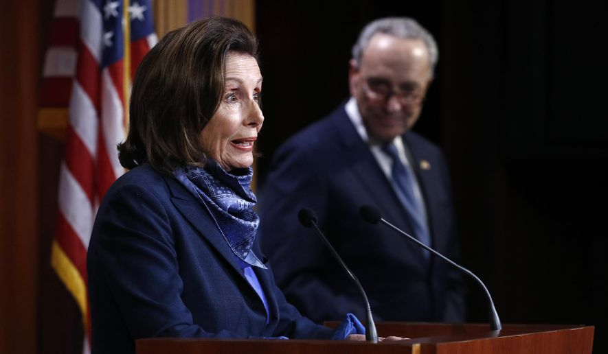 House Speaker Nancy Pelosi of Calif., speaks with reporters alongside Senate Minority Leader Sen. Chuck Schumer of N.Y. after the Senate approved a nearly $500 billion coronavirus aid bill, Tuesday, April 21, 2020, on Capitol Hill in Washington. (AP Photo/Patrick Semansky) **FILE**