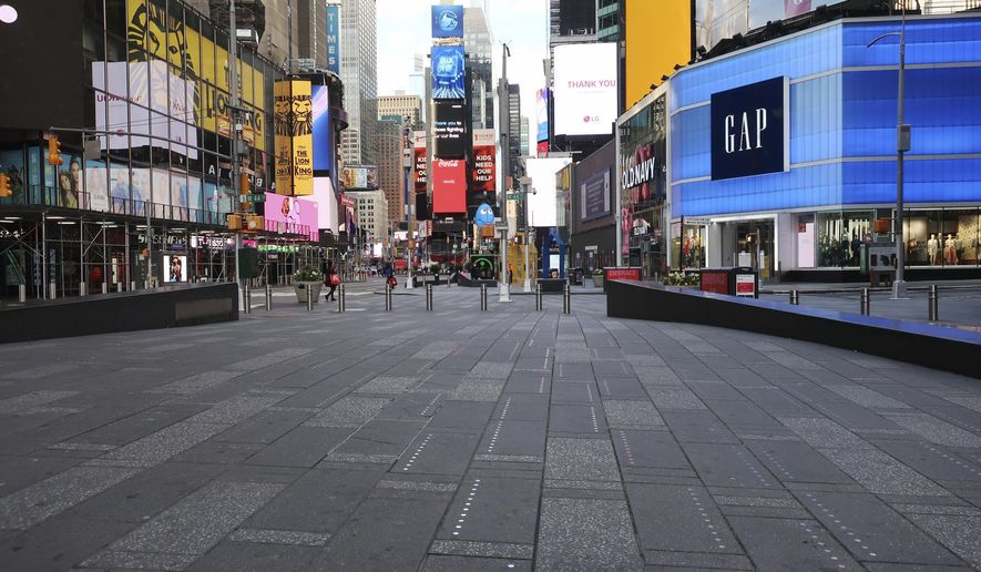 Times Square is nearly empty of pedestrians during the coronavirus pandemic in New York City on Tuesday, April 21, 2020. (AP Photo/Ted Shaffrey)