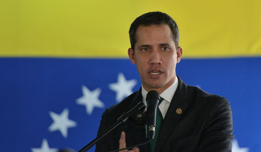 Opposition leader Juan Guaido speaks during a press conference in Caracas, Venezuela, Monday, March 9, 2020. (AP Photo/Matias Delacroix) ** FILE **