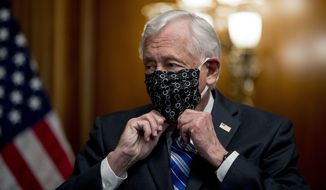 House Majority Leader Steny Hoyer of Md. puts his mask on after speaking during a signing ceremony for the Paycheck Protection Program and Health Care Enhancement Act, H.R. 266, after it passed the House on Capitol Hill, Thursday, April 23, 2020, in Washington. The almost $500 billion package will head to President Donald Trump for his signature. (AP Photo/Andrew Harnik)