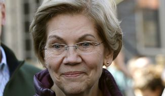 In this March 5, 2020, photo, Sen. Elizabeth Warren, D-Mass., speaks to the media outside her home in Cambridge, Mass., after she dropped out of the Democratic presidential race. Warren said Thursday, April 23, that her brother Donald Reed Herring had died Tuesday after testing positive for the coronavirus. He was 86 and died in Norman, Okla. (AP Photo/Steven Senne) **FILE**