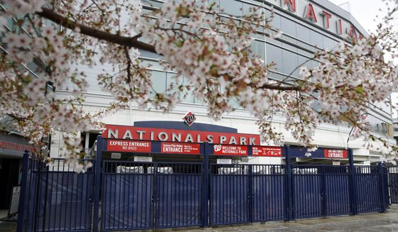 This Wednesday, March 25, 2020, photo shows closed gates at Nationals Park in Washington. With the start of the Major League Baseball season indefinitely on hold because of the novel coronavirus pandemic, ballparks will be empty Thursday on what was supposed to be opening day.  (AP Photo/Patrick Semansky)