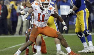 FILE - In this Dec. 1, 2018, file photo, Clemson's Isaiah Simmons (11) reacts after making a play against Pittsburgh in the first half of the Atlantic Coast Conference championship NCAA college football game in Charlotte, N.C. Simmons is a likely first-round pick in the NFL draft Thursday, April 23, 2020. (AP Photo/Chuck Burton, File)