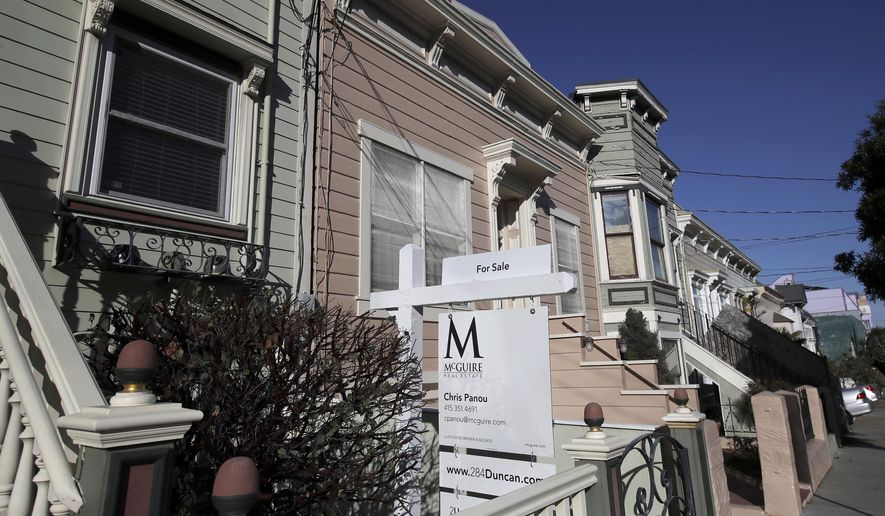 FILE - This Feb. 18, 2020, photo shows a real estate sign in front of a home for sale in San Francisco. Long-term mortgage rates rose slightly this week, continuing to hover near all time lows amid anxiety over the economy and housing market gut punched by the shutdown spurred by the coronavirus pandemic.  (AP Photo/Jeff Chiu, File)