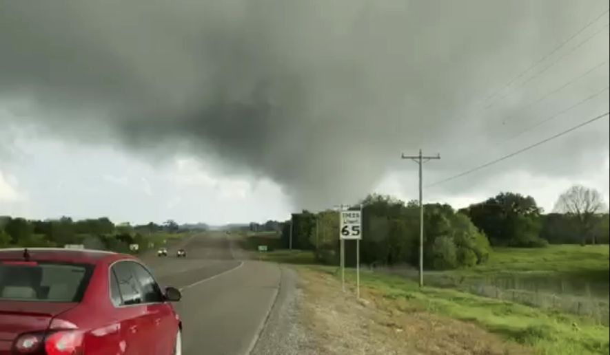 This image made from video provided by Thomas Marcum shows a tornado seen from State Highway 48 in Durant, Okla., Wednesday, April 22, 2020. (Thomas Marcum via AP)
