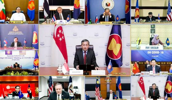 In this photo provided by the Singapore Ministry of Foreign Affairs, Singaporean Foreign Minister Vivian Balakrishnan, center, speaks from Singapore during a videoconference on COVID-19 between ASEAN Foreign Ministers and U.S. Secretary of State Mike Pompeo  Thursday, April 23, 2020. (Singapore Ministry of Foreign Affairs via AP)