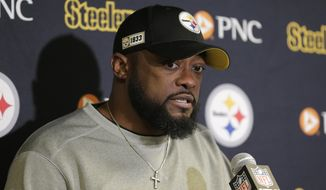 FILE - In this Dec. 22, 2019, file photo, Pittsburgh Steelers head coach Mike Tomlin talks during a post game news conference after an NFL football game against the New York Jets in East Rutherford, N.J. The NFL Draft is April 23-25, 2020. (AP Photo/Seth Wenig, File)