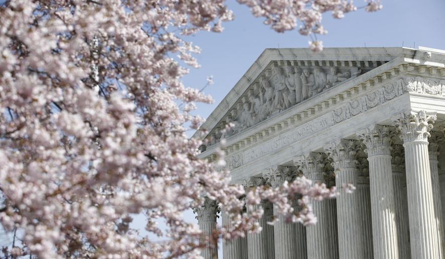 In this March 16, 2020, file photo, a tree blooms outside the Supreme Court in Washington. (AP Photo/Patrick Semansky, File)