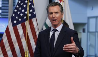 In this April 14, 2020, file photo, California Gov. Gavin Newsom gestures during a news conference at the Governor's Office of Emergency Services in Rancho Cordova, Calif. A conservative organization has petitioned the California Supreme Court to block the state's first-in-the-nation plans to give money to immigrants living in the country illegally who are hurt by the coronavirus. The Center for American Liberty argued that the $75 million plan announced by Gov. Gavin Newsom last week is barred by both state and federal law. (AP Photo/Rich Pedroncelli, Pool, File)