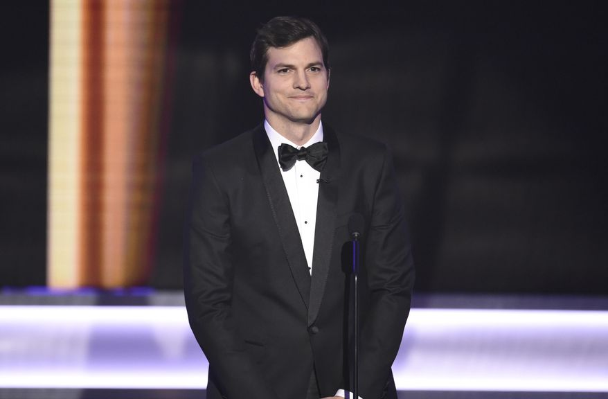 FILE - In this Jan. 29, 2017 file photo, actor and entrepreneur Ashton Kutcher appears at the 23rd annual Screen Actors Guild Awards in Los Angeles. Iowa Gov. Kim Reynolds said Thursday, April 23, 2020 that the state's $26 million contract with Utah companies to increase coronavirus testing was developed after she got unsolicited advice from Iowa native Kutcher. (Photo by Chris Pizzello/Invision/AP File)