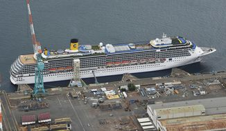 Italian-operated cruise ship the Costa Atlantica is anchored at a port in Nagasaki, southern Japan, Thursday, April 23, 2020. The Costa Atlantica docked since late January is struck by an onboard coronavirus outbreak in which dozens of crew members found to have infected, sending health officials in the southern Japanese city almost free of the virus scrambling to find clues to how the infections started on the ship. (Kyodo News via AP)