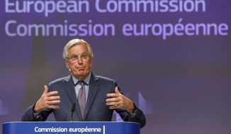 The European Commission's Head of Task Force for Relations with the United Kingdom Michel Barnier gestures as he speaks during a media conference at EU headquarters in Brussels Friday April 24, 2020. (AP Photo/Olivier Matthys)