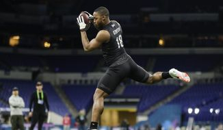 Memphis wide receiver Antonio Gibson runs a drill at the NFL football scouting combine in Indianapolis, Thursday, Feb. 27, 2020. (AP Photo/Michael Conroy)  **FILE**