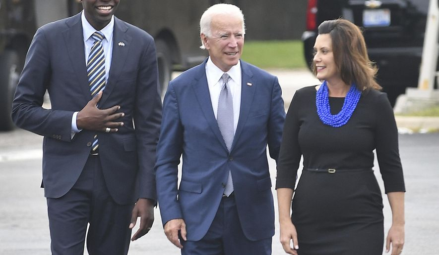 In this Sept. 12, 2018 file photo, from left, gubernatorial running mate Garland Gilchrist, former Vice President Joe Biden and Michigan Democratic gubernatorial candidate Gretchen Whitmer arrive at Leo's Coney Island in Southfield, Mich. On Friday, April 24, 2020, The Associated Press reported on photos circulating online incorrectly asserting Biden and Whitmer violated social distancing rules on April 9, 2020. The September 2018 photos were made when Biden was campaigning in Michigan for Whitmer. (Daniel Mears/The Detroit News via AP)\