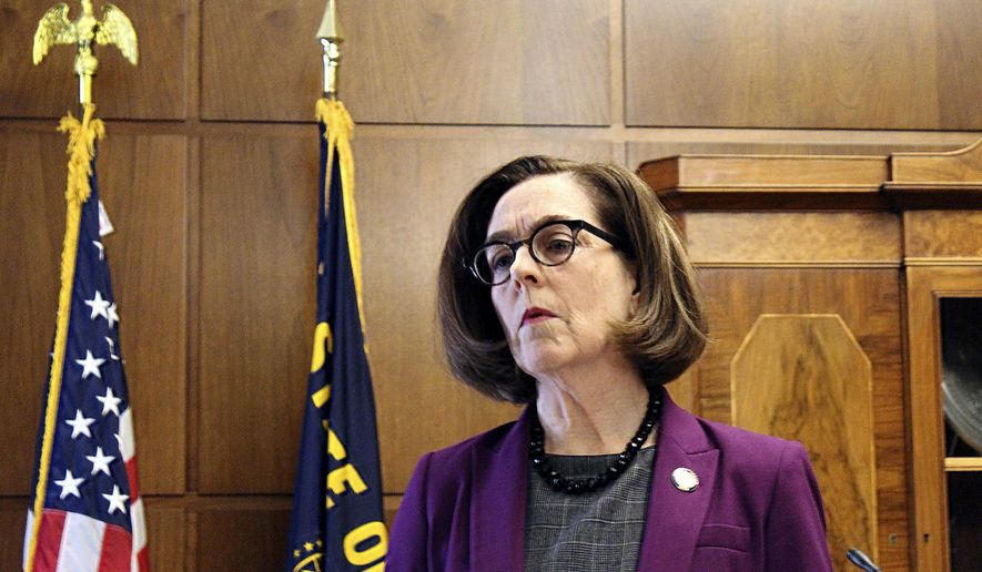 In this Feb. 24, 2020, photo, Oregon Gov. Kate Brown denounces a walkout by Republicans in the state Senate that prevented a quorum in Salem, Ore. Brown has acknowledged repeatedly that she recognizes her stay-home order is painful but is the only way to keep the coronavirus from spreading, and the state must be careful in lifting the restrictions. (AP Photo/Andrew Selsky) **FILE**