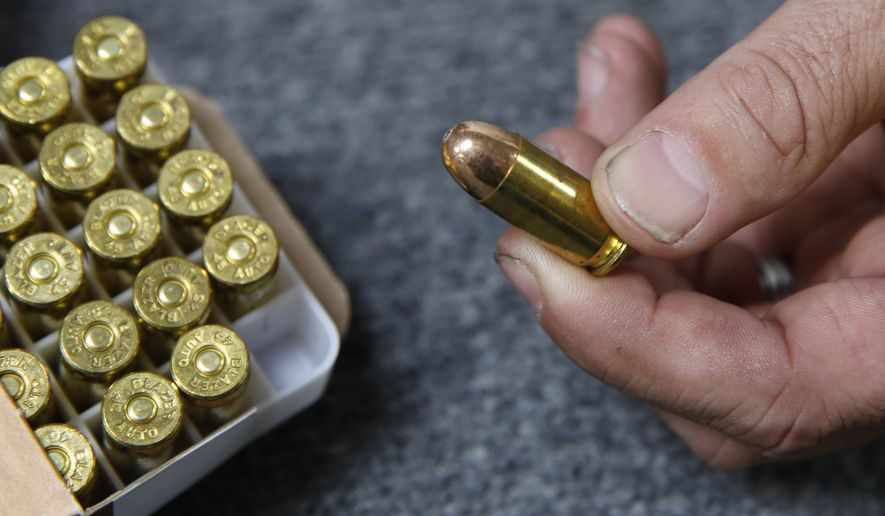 In this June 11, 2019, file photo, Chris Puehse, owner of Foothill Ammo, displays .45-caliber ammunition for sale at his store in Shingle Springs, Calif. An appeals court on Friday, April 24, 2020, has reinstated a California law requiring background checks for people buying ammunition, reversing a federal judges decision to stop the checks that he said violate the constitutional right to bear arms. The law, which took effect last July, requires Californians to pass an in-store background check before buying ammunition, which involves running buyers names through a California Department of Justice database that tracks legal purchases of guns. (AP Photo/Rich Pedroncelli, File)