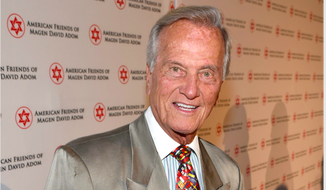 Iconic singing star Pat Boone has stepped up to record once again, this time to raise money for protective gear for personal responders through the National Sheriff's Association. (AP Photo) ** FILE **