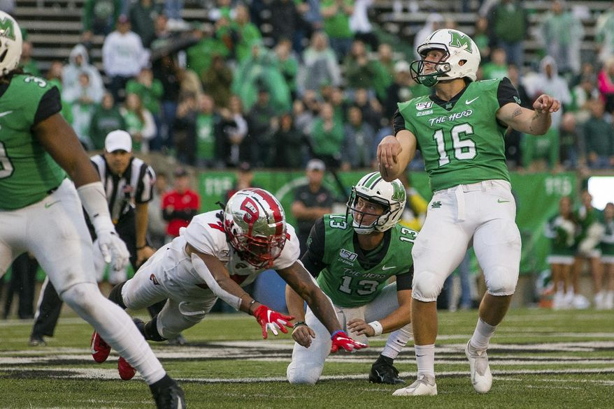 In this Oct. 26, 2019, file photo, Marshall kicker Justin Rohrwasser (16) hits a 53-yard game winning field goal against Western Kentucky during an NCAA college football game in Huntington, W.Va. New Patriots kicker Justin Rohrwasser says a tattoo on his arm is not representative of a loosely organized right-wing militia group that has adopted the symbol. Rohrwasser, who played at Rhode Island and Marshall, was taken 159th overall in the fifth round of the draft Saturday, April 25, 2020.(Sholten Singer/The Herald-Dispatch via AP) ** FILE **