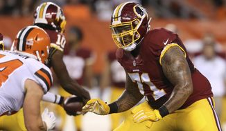 In this Aug. 13, 2015, file photo, Washington Redskins tackle Trent Williams (71) blocks Cleveland Browns linebacker Scott Solomon (54) during an NFL preseason football game in Cleveland. The San Francisco 49ers have acquired the seven-time Pro Bowl left tackle from the Redskins. Two people familiar with the deal said Saturday, April 25, 2020,  the Niners will send a fifth-round pick in this year's draft and a 2021 third-rounder to acquire Williams.  (AP Photo/Ron Schwane) ** FILE **
