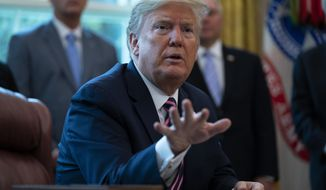 President Donald Trump speaks after signing a coronavirus aid package to direct funds to small businesses, hospitals, and testing, in the Oval Office of the White House, Friday, April 24, 2020, in Washington. (AP Photo/Evan Vucci)