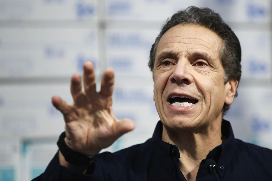 In this March 24, 2020, file photo, New York Gov. Andrew Cuomo speaks during a news conference at the Jacob Javits Center in New York. With New York City at the epicenter of the coronavirus outbreak in the U.S. and its native-born among those offering crucial information to the nation in televised briefings, the New York accent has stepped up to the mic. Cuomo's news conferences have become must-see TV. (AP Photo/John Minchillo, File)