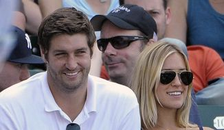 In this July 2, 2011, file photo, Chicago Bears quarterback Jay Cutler, left, and his wife Kristin Cavallari watch the Chicago Cubs play the Chicago White Sox during an interleague baseball game in Chicago. Reality TV star Cavallari and former Chicago Bears quarterback Cutler are getting divorced. Cavallari announced Sunday, April 26, 2020, in an Instagram post that the couple are breaking up after seven years of marriage and a decade together. (AP Photo/Brian Kersey, File)